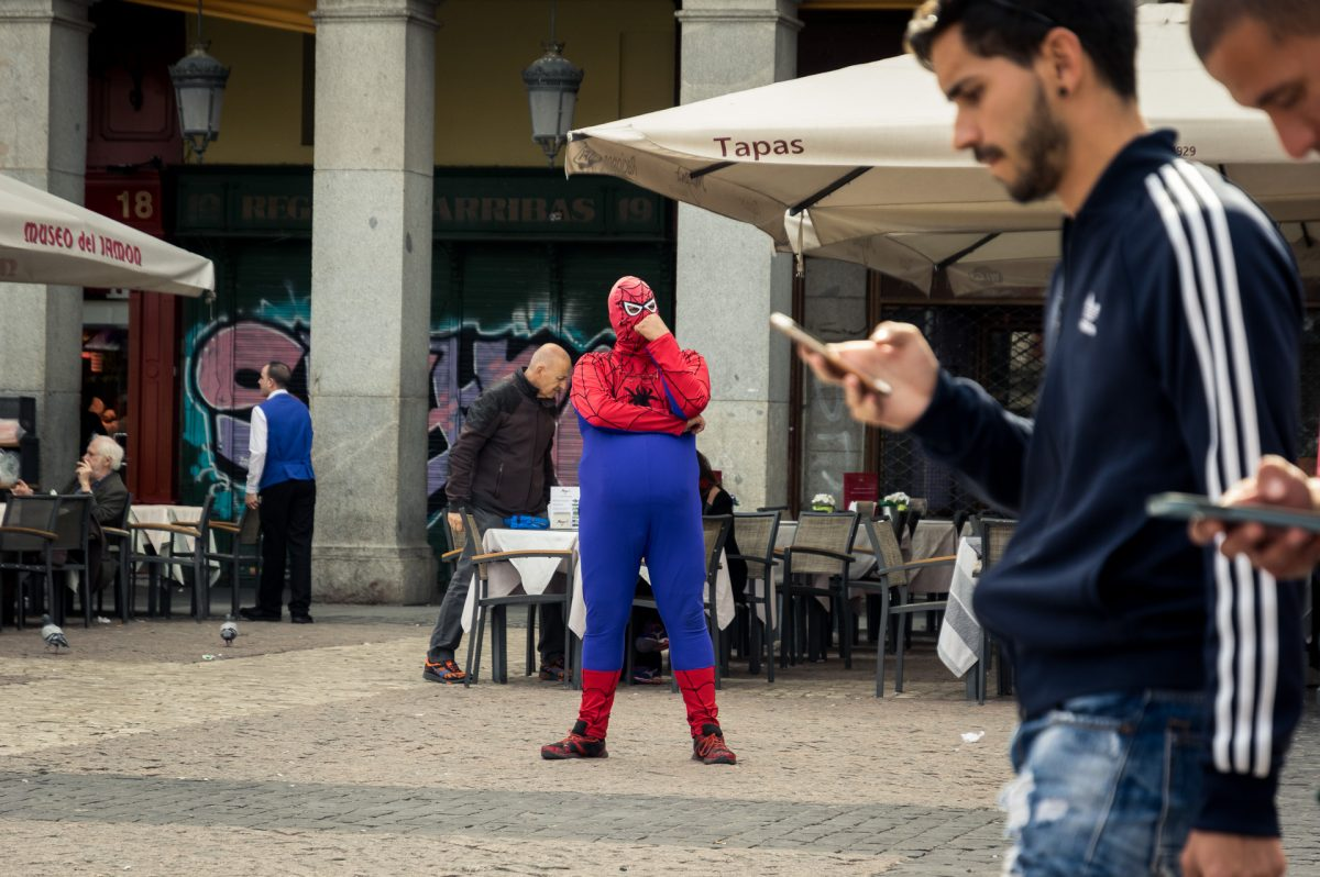 A street artist dressed as a fat spiderman in Madrid's biggest square