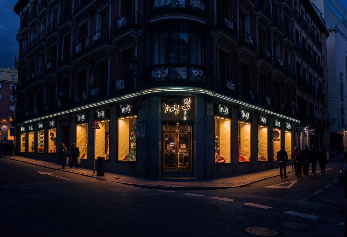 Night photo of building in Madrid with lighten windows