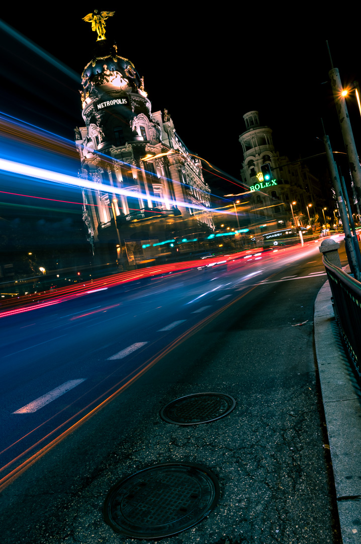 Long exposure of the traffic on the corner of Metropolis building in Gran Via, Madrid