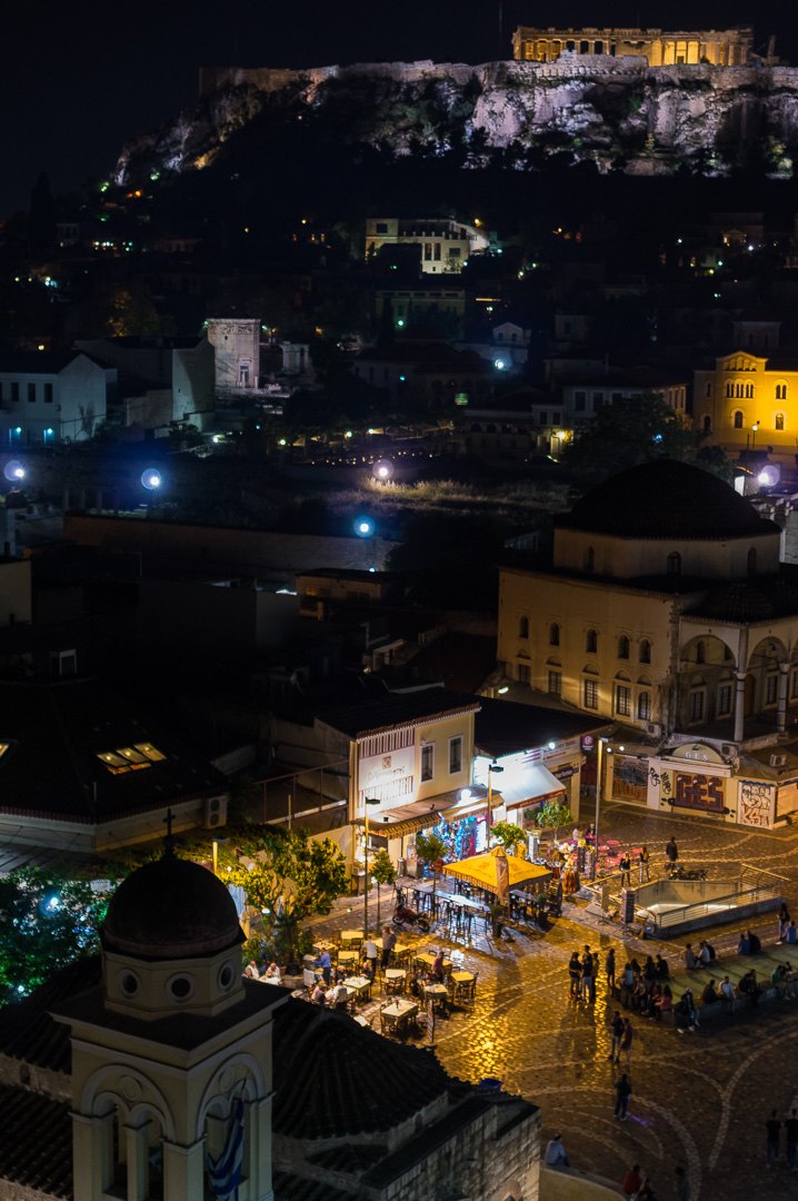 Monastiraki square during the night and Acropolis on the background