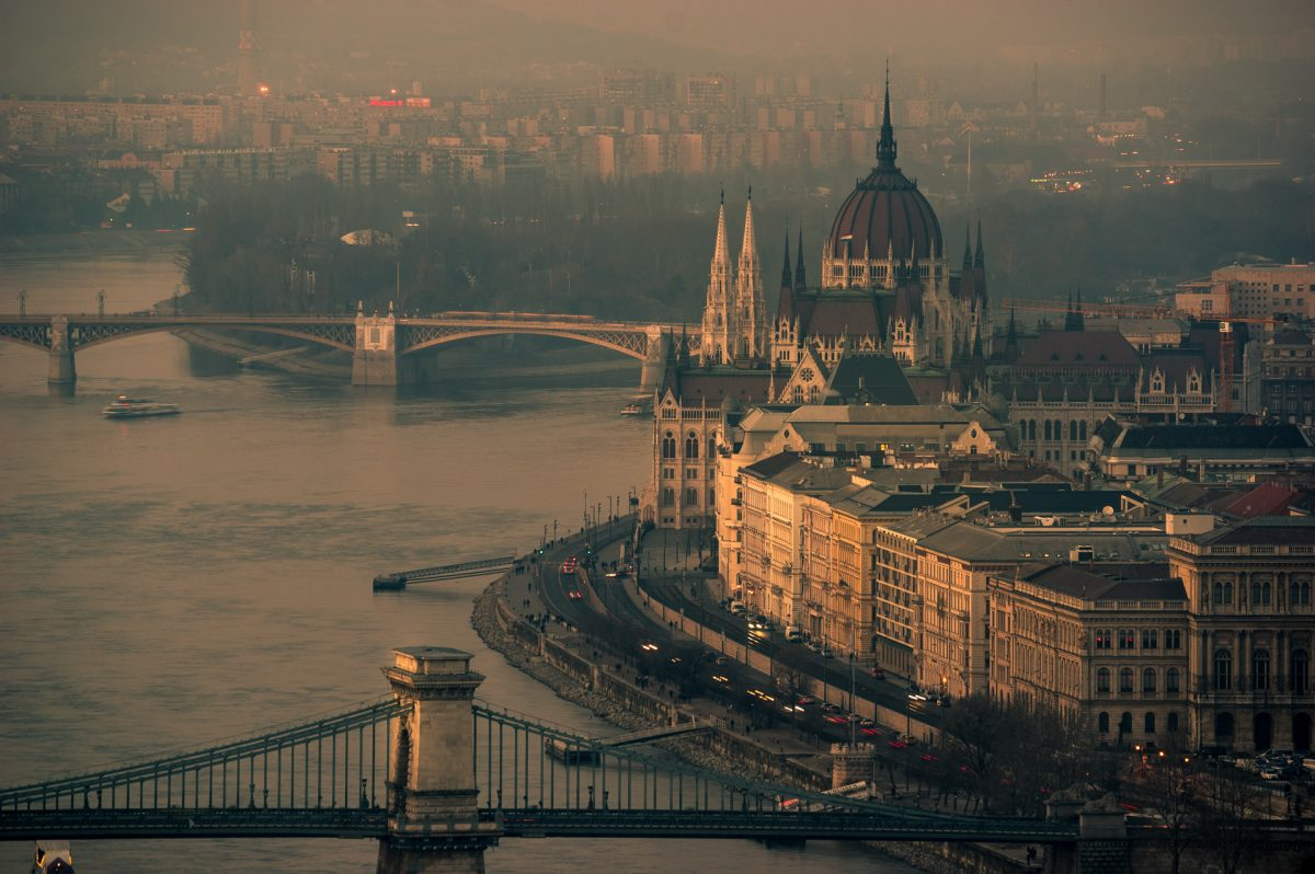 The Hungarian parliament and Chain bridge on the east bank of Danube in Budapest, Hungary