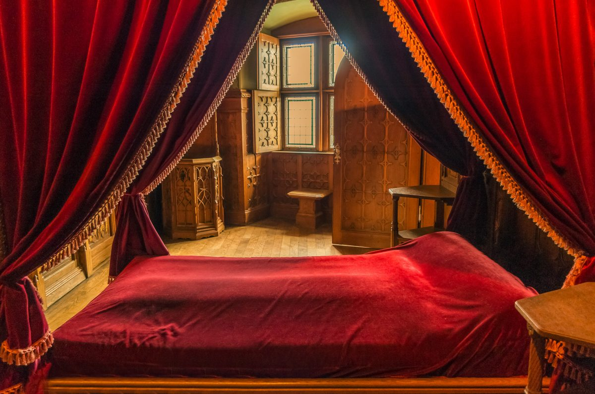 Medieval bedroom with an all red bed