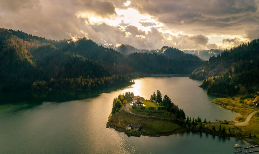 Aerial view of Colibita lake in Romania and the small island in the middle of the lake